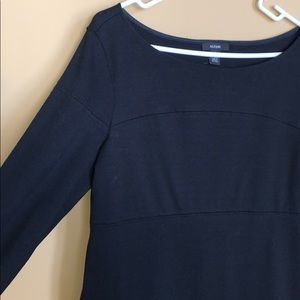 Classic, fitted, stretchy, sleeved black dress